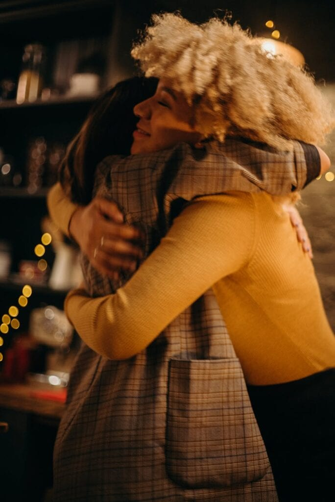 two person hugging photograph